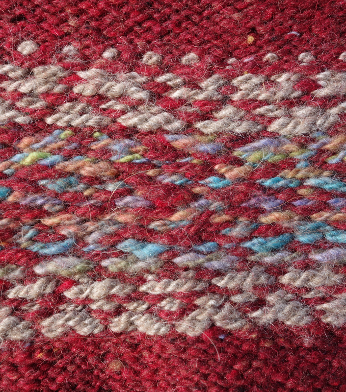 Reverse of colour work section using handspun and commercial yarn
