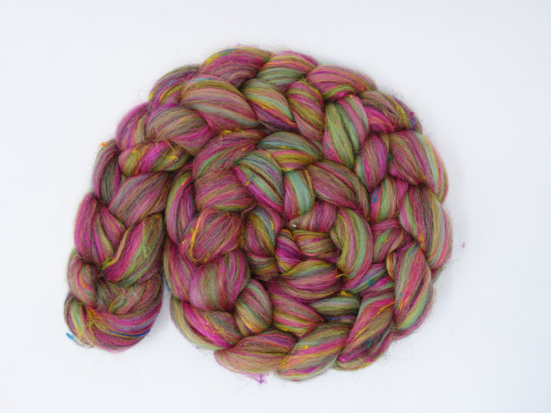 A braid of fibre with streaks of Pink, Lime and Aqua